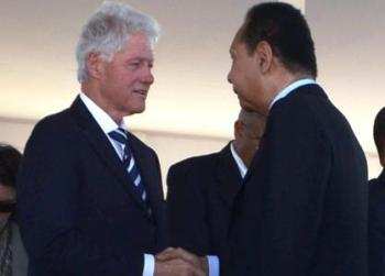 U.N. Special Envoy – and former U.S. President – Bill Clinton greets Baby Doc on Jan. 12, 2012, at the earthquake commemoration ceremony at Titanyen, outside of Port au Prince, where hundreds of thousands of earthquake victims are buried in mass graves, thus legitimizing the one-time dictator's presence in the country he had ravaged. – Photo: Haiti Information Project
