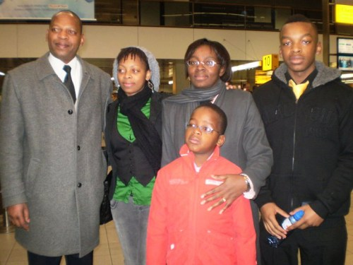 Victoire Ingabire's family at the airport before Victoire departed for Rwanda in January 2010: her husband Lin Muyizere, left, daughter Raissa Ujeneza, center left, Victoire, center right, son Remy Ndizeye Niyigena, right, and son Rizst Shima, front