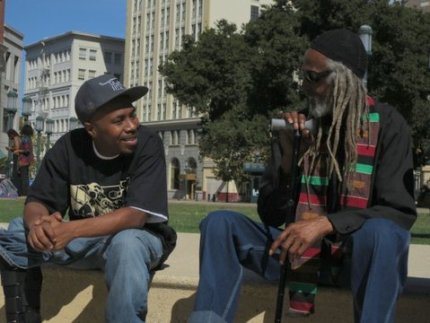 Minister of Information JR talks with Elder Freeman, the man who taught him the fundamentals of African communalism, during a Black Panther Party 46th Anniversary event at Oscar Grant Plaza in Oakland on Oct. 13, 2012. – Photo: Carole Hyams-Howard