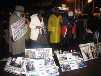 "In the freezing New York cold on Jan. 12, 2015, Haitians protest in front of Bill Clinton's Harlem office, saying ""No to dictatorship, down with the U.N., down with the U.S. puppet Martelly government!"" – Photo: Dahoud Andre"