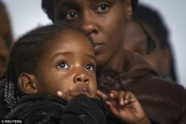 """I miss my daddy,"" 2-year-old Akaila Gurley told the crowd at a protest. – Photo: Reuters"