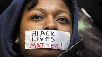 'Black Lives Matter' taped over young Black woman's mouth