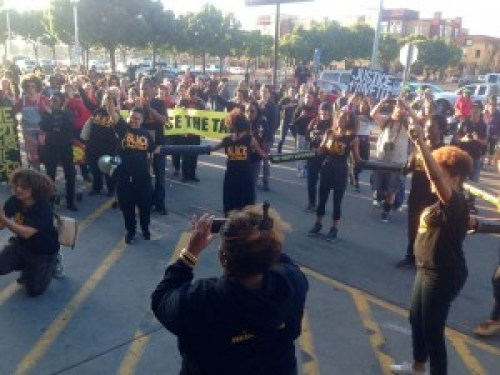 Fists in the air, protesters celebrated the five-hour shutdown of Home Depot in Emeryville. – Photo: Forrest Schmidt