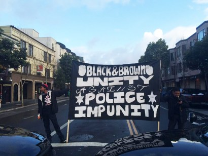 As Black-Brown solidarity grows in the Bay Area, the focus March 22-23 was on the first anniversary of the San Francisco police murder of Alex Nieto, marked with a cultural commemoration Sunday, followed by an early Monday morning shutdown of the street outside the Mission Police Station for a people's trial of the four officers who killed Alex. – Photo: Freddie, Twitter