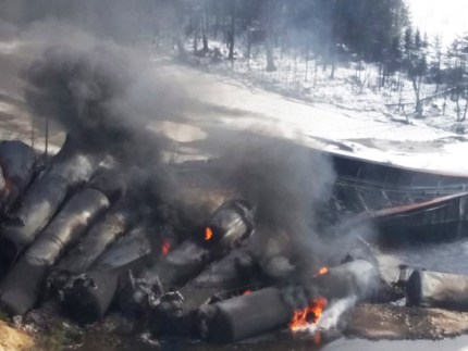 """The train that derailed March 8 near Gogama, Ontario, the third CN derailment in a month, spilled crude into a river and the fire spewed toxins that caused widespread breathing problems. Chief Walter Naveau of the Mattagami First Nation says his community does not feel safe despite CN's assurances that the disaster posed no threat to people or the environment, saying, """"Why should I trust them?"""" He fears poisoning of his people and the fish spawning grounds they depend on. – Photo: Glenn Thibeault, Canadian Press"""
