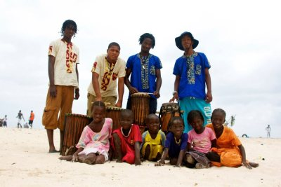 The local children wanted their picture taken with the four young Chicago bucket drummers – here they've been loaned African drums – on the beach in Senegal.