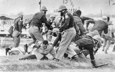 Alabama State Troopers beat John Lewis, then a young SNCC (Student Nonviolent Coordinating Committee) leader, now a longtime member of Congress, on Bloody Sunday, March 7, 1965. Because of the steep pitch of the bridge, the 600 marchers, protesting the murder by a state trooper of Jimmy Lee Jackson, couldn't see the attack awaiting them on the other side. Troopers beat them with clubs and trampled them with horses.