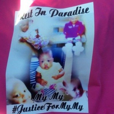#JustceForMyMy shirts were worn by members of her family during her funeral services.