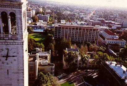 This view from a kite of UC Berkeley shows the clock and bell tower known as The Campanile on the left, Barrows Hall in the center and Telegraph Avenue stretching off into the distance. – Photo: Charles C. Benton