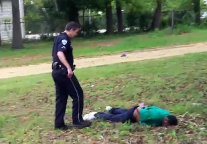 "A frame from the video recorded April 4 by a passerby – a ""hero,"" according to the victim's family's attorney – shows Officer Michael Slager, 33, checking out Walter Scott, 50, the man he had stopped for a faulty taillight, then shot eight times in the back as he ran. The video also shows Slager planting his Taser next to Scott as he lay dead or dying. Slager has been fired and charged with murder."