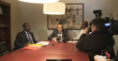 University of Quebec professor Emmanuel Hakizimana, left, attorney and former ICTR defense counsel John Philpot and Paul Kagame's former Chief of Staff David Himbara hold a press conference in Montreal.