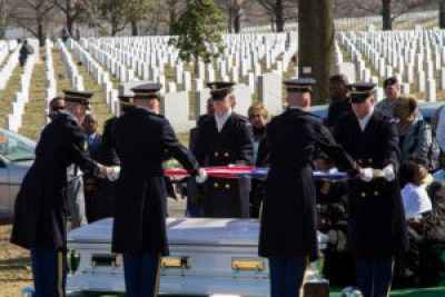 The Arlington National Cemetery honor guard folds the flag for the reburial of Wyley and Ouida Wright. – Photo: Andre Thompson courtesy Ray Caling