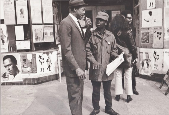 Panthers John Bowman and Emory Douglas talk with people in front of the Fillmore office, located on Fillmore and  Ellis, the corner Yoshi's later made famous.