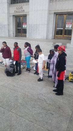 """Youth skolas of Deecolonize Academy in Deep East Oakland line up to speak at the anti-eviction rally outside """"Eviction Kkkort,"""" the Alameda County Courthouse, site of many Black Panther demonstrations back in the day. – Photo: Poor News Network"""