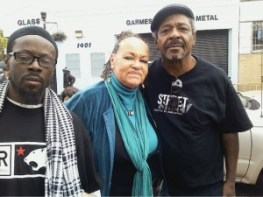 Mesha Irizarry, who lost her only child, Idriss Stelley, to a police murder in 2001, and Bilal Ali, right, organized Malcolm X Day at Third and Palou, which featured Jabari Shaw, left, well known advocate for justice, whose car was rammed by U.S. Marshals and officers from OPD and the FBI in March, causing severe injuries to him, his friend, who may never walk again, and his little daughter. – Photo: Rochelle Metcalfe