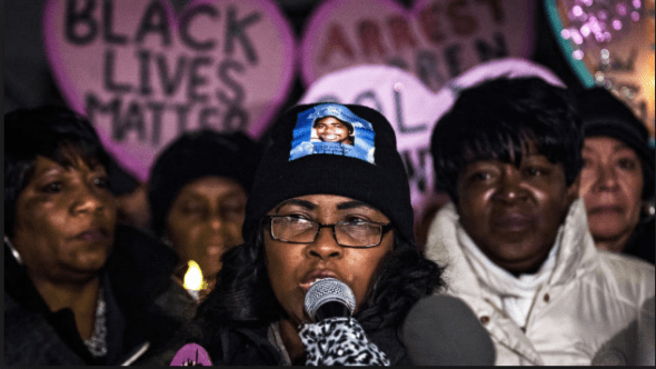 Rev. Wanda Johnson, Oscar Grant's mother, speaks at a candlelight vigil in Washington, D.C., last December with other mothers whose sons were murdered by police. – Photo: J. Lawler Duggan, Washington Post
