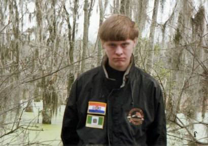 Dylann Storm Roof wears a jacket with the flags of apartheid-era South Africa and white-ruled Rhodesia in a photo on his Facebook page. He was arrested in North Carolina on June 18.