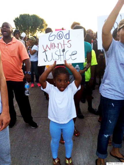 On Monday, June 8, McKinney, Texas, turned out to demand justice, which, according to this little girl, is God's will. – Photo: Elroy Johnson