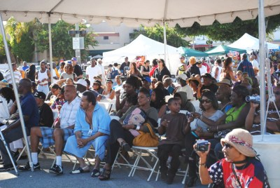 The Book Fair audience watches a performance by A Jimi Hendrix Tribute Band during a tribute to the '60s at the 2010 fair.