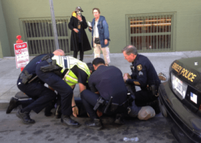 Berkeley copwatchers observe an arrest.