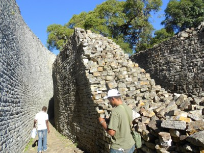 Dr. Chris Zamani explores the gracefully curving stone walls of the ancient city known as Great Zimbabwe, the capital of a booming trading empire that flourished in gold-rich Southern Africa between the 11th and 15th centuries.
