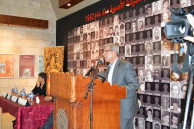 """Issa Qaraka, the head of the Ministry of Prisons in Palestine, addresses the exhibition audience and closes his comments with a quotation from Huey P. Newton's revolutionary eulogy for Jonathan Jackson: """"If the penalty for the quest for freedom is death, then by death we escape to freedom."""""""