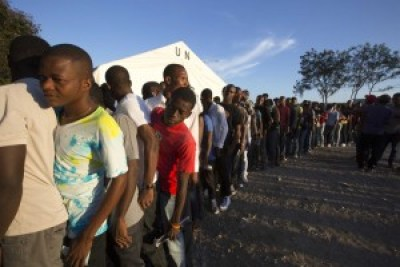 "Tired of Martelly's rule by decree, Haitians lined up Aug. 9 to elect 139 legislators in an election memorable for Martelly government-sponsored voter suppression, violence and corruption. Calling it an ""electoral coup d'état,"" many now want it annulled. – Photo: Dieu Nalio Chery, AP"