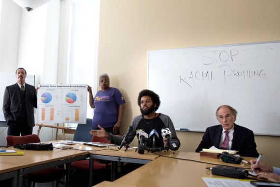"""Mansour Id-Deen of the Berkeley NAACP, left, with representatives of Berkeley Copwatch and the UC Berkeley Black Student Union present racial profiling data to the Berkeley Police Department on Sept. 29, 2015. The three, part of a coalition that also includes the National Lawyers Guild, the Peace and Justice Commission and the ACLU, analyzed nearly seven months of data on about 4,700 traffic stops, finding that 30.5 percent involved Black motorists, whereas the Black population, according to Id-Deen, is close to 5 percent. Berkeleyside reports, """"Id-Deen said the coalition believes the traffic stop data is evidence of 'illegal patterns and practices by some members of the Berkeley Police Department' that give weight to concerns expressed by people of color 'for a very, very long time here in Berkeley' about racial profiling and over-policing."""" – Photo: Emilie Raguso, Berkeleyside"""