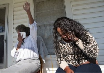 Ashley Diamond's mother Diane, left, and one of her sisters, Diana Diamond-Wilson, are upset by something Ashley is telling them during a rare phone call with her from prison, in Rome, Georgia, March 24, 2015. Trans women sent to male prisons are at high risk for sexual assault. One study found that 59 percent of trans women in California's male prisons had been sexually assaulted while incarcerated compared to 4 percent of the cisgender male population. – Photo: Ruth Fremson, The New York Times