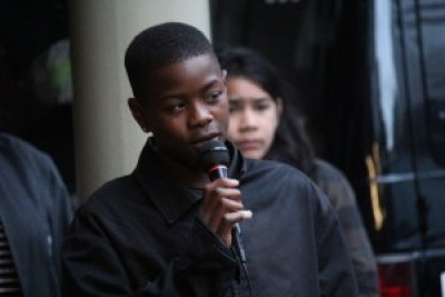 "Tyray Taylor, 13, a student at Deecolonize Academy, describes the oppression of children generated by ""Broken Windows"" style private policing. – Photo: Suze Leon, Poor News Network"