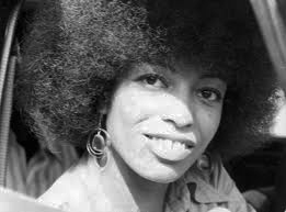Angela Davis, wearing her famously natural hairstyle, is released from prison after all charges were dropped in June 1972.