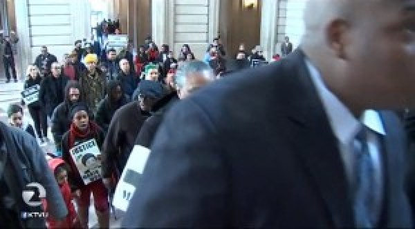 Over a hundred protesters poured into City Hall after their rally on the steps outside, headed to Mayor Ed Lee's office. – Video frame: KTVU