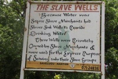 This sign is near the site of a 300-year-old baobab tree and water wells used for slaves in northern Ghana.