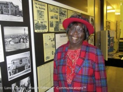 Espanola Jackson enjoys a Bayview Hunters Point history exhibit at George Washington Carver Elementary School during a tribute to elders by the schoolchildren. – Photo: Lance Burton, Planet Fillmore Communications