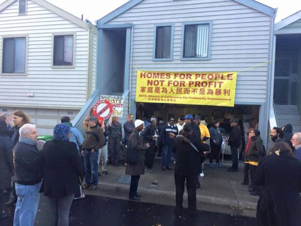 Supporters of Pastor Dorn gathered Jan. 13 outside his house in Hunters Point succeeded in stopping his threatened eviction that day.