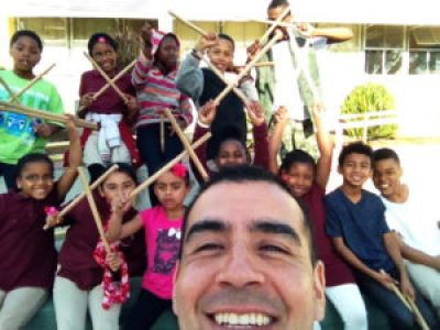 Miguel Gonzalez with one of his New Urban Drum Culture classes