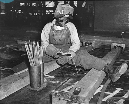 "With ""Rosie"" painted on her welding hood – most of the World War II ""Rosie the Riveters"" were Black – Josie Lucille Owens works at the Kaiser Shipyard in Richmond, where nearly 1,000 Black women were employed, building the Liberty Ship SS George Washington Carver, launched May 7, 1943. – Photo: National Archives"