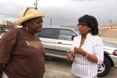 "Sharon Jasper, leader of the ""Bring the People Home"" movement to allow 4,500 New Orleans families to return to their perfectly livable public housing apartments after Katrina, most untouched by the flood, discusses strategy with Congresswoman Maxine Waters, the only member of Congress who devoted herself to enabling poor New Orleanians to recover. Despite their brilliant and valiant efforts, public housing was almost entirely demolished in New Orleans. In the years since then, city after city has privatized and/or demolished its public housing, driving thousands of residents – families, the elderly and the disabled – into homelessness."