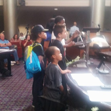 Deecolonize students testify at the marathon City Council meeting April 5 on a 90-day evictions moratorium as one way to slow down gentrification. – Photo: Poor News Network