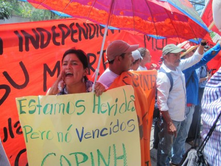 """We are hurt but not defeated, COPINH,"" the sign reads. – Photo: Jeanette Charles"