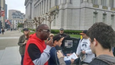 Pastor Yul Dorn shares his story outside of the City Hall.