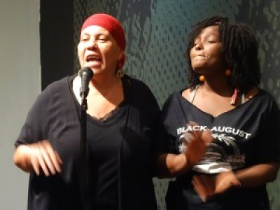 Mama Ayanna, after greeting and welcoming friends at the door, hosted the show with other members of the Malcolm X Grassroots Movement, the lead organizer of the Mutulu Is Welcome Here campaign. – Photo: Wanda Sabir