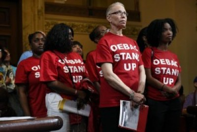Members of the Oakland East Bay Alumnae Chapter of Delta Sigma Theta resolutely wait their turn to be among the 200 who testified for a moratorium on evictions and rent increases at the April 5 Oakland City Council meeting. Another 200 were forced to wait outside the doors of the packed council chambers. – Photo: Michael Short, SF Chronicle