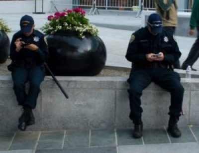 Police officers texting by Arlen, Twitter