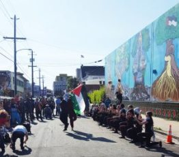 The Silk Road Debke Troupe dance in front of the Oakland Palestine Solidarity Mural. – Photo: Greg Thomas