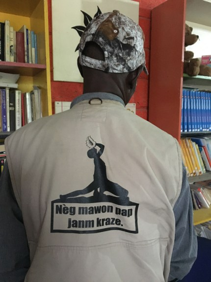 """On the back of this Haitian man's jacket is an image of the iconic Haitian maroon revolutionary with the message: """"The spirit of the Haitian people will never break."""" – Photo: Marilyn Langlois"""