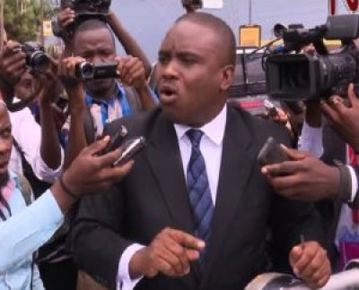 Press surround Kampala Lord Mayor Erias Lukwago before his arrest on May 3, 2016.