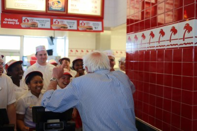 "At In-and-Out Burger in Pinole, the sort of diner that serves the people Bernie Sanders champions, he speaks to the staff. A comment to the photo on his Facebook page reads: ""Their faces speak volumes. No way does Hillary get this much excitement!"""