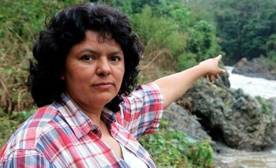 Berta Caceres points to the beautiful river that if dammed could endanger and even destroy her people the way the Chalillo Dam threatens the Mayan people of Belize.