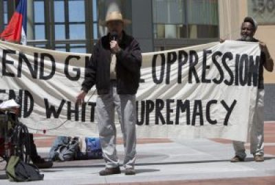 """Dave Welsh of the San Francisco Labor Council described the council's historic support for the people of Haiti. The sign behind him reads, """"End global oppression; end white supremacy."""" – Photo: Malaika H Kambon"""